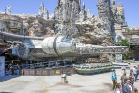 The front of the Millennium Falcon parked in a docking bay at Black Spire Outpost on Batuu in Disneyland's Star Wars: Galaxy's Edge. Photo by Mark Eades.