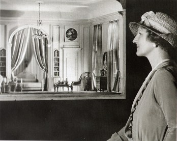 A woman looking at the miniatures displayed in The Thorne Room