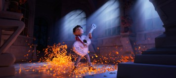 """ASPIRING MUSICIAN — In Disney•Pixar's """"Coco,"""" Miguel (voice of newcomer Anthony Gonzalez) dreams of becoming an accomplished musician like the celebrated Ernesto de la Cruz (voice of Benjamin Bratt). But when he strums his idol's guitar, he sets off a mysterious chain of events. Directed by Lee Unkrich, co-directed by Adrian Molina and produced by Darla K. Anderson, """"Coco"""" opens in theaters Nov. 22, 2017."""