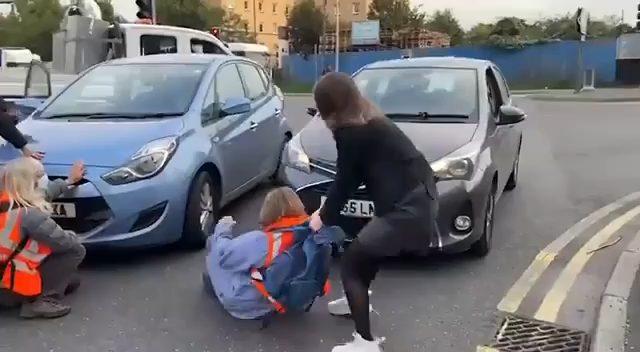Man Loses Job Because Environmental Idiots Lay in Street Blocking Traffic