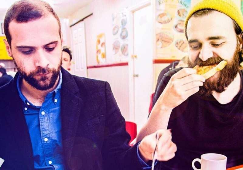Frauds eating a fried breakfast