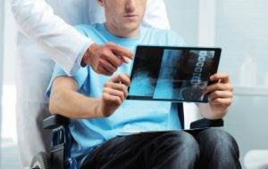 Tampa Florida Doctor reviews spinal cord x-rays with Injury Patient.