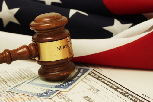 Gavel bangs down near Flag as Social Security Benefits are denied.