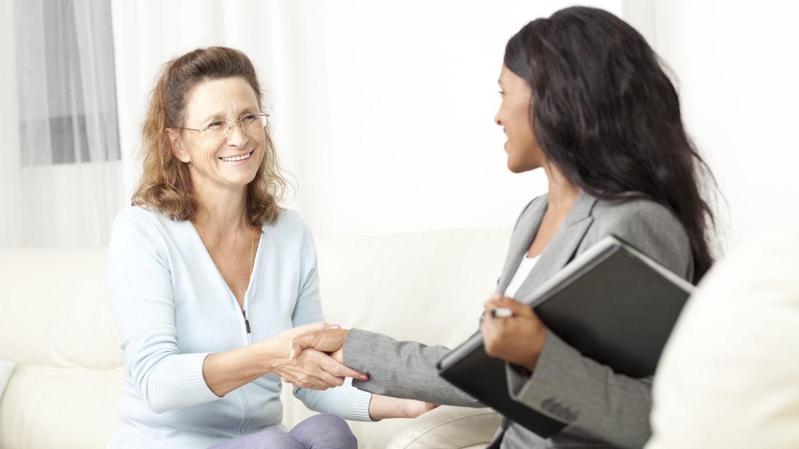 Social security lawyer consults a client in her home