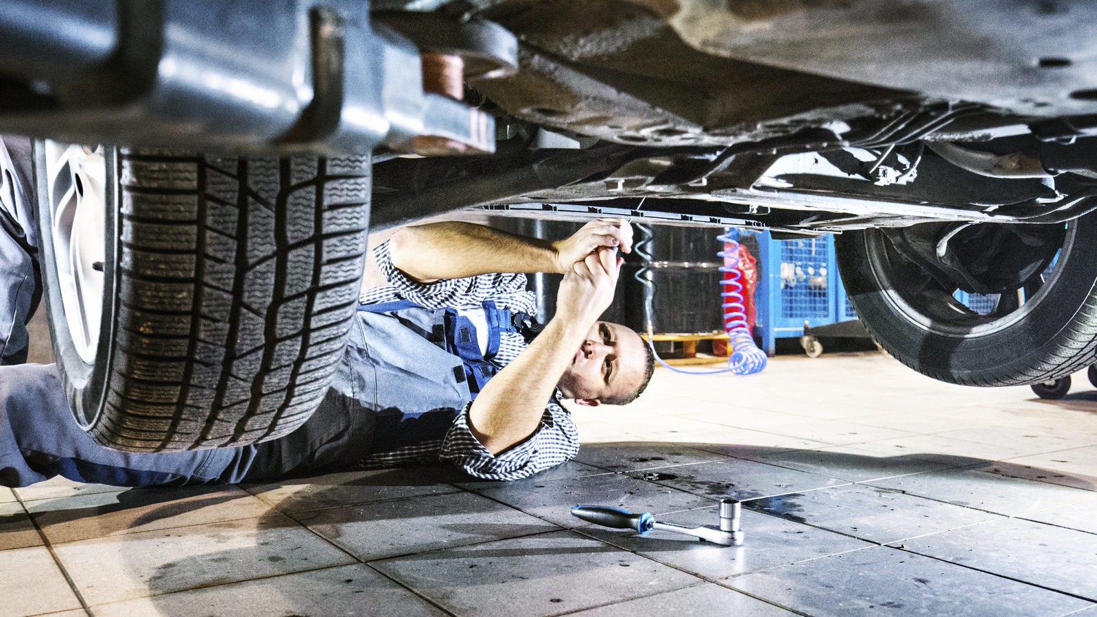 mechanic working on car after an accident