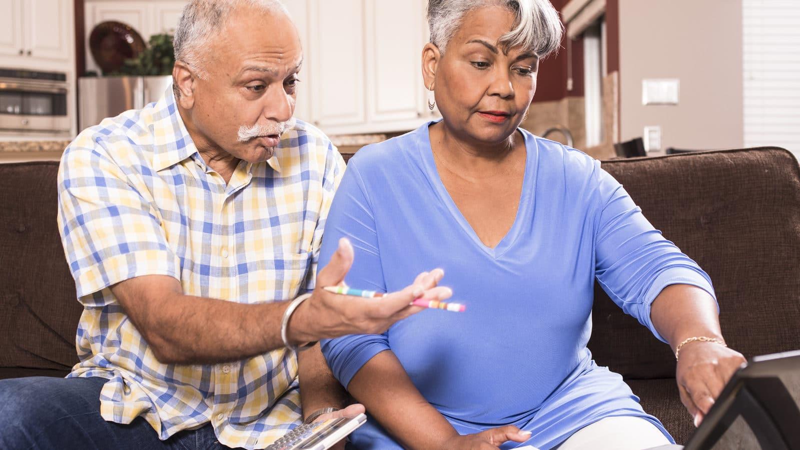 Senior couple paying medical bills