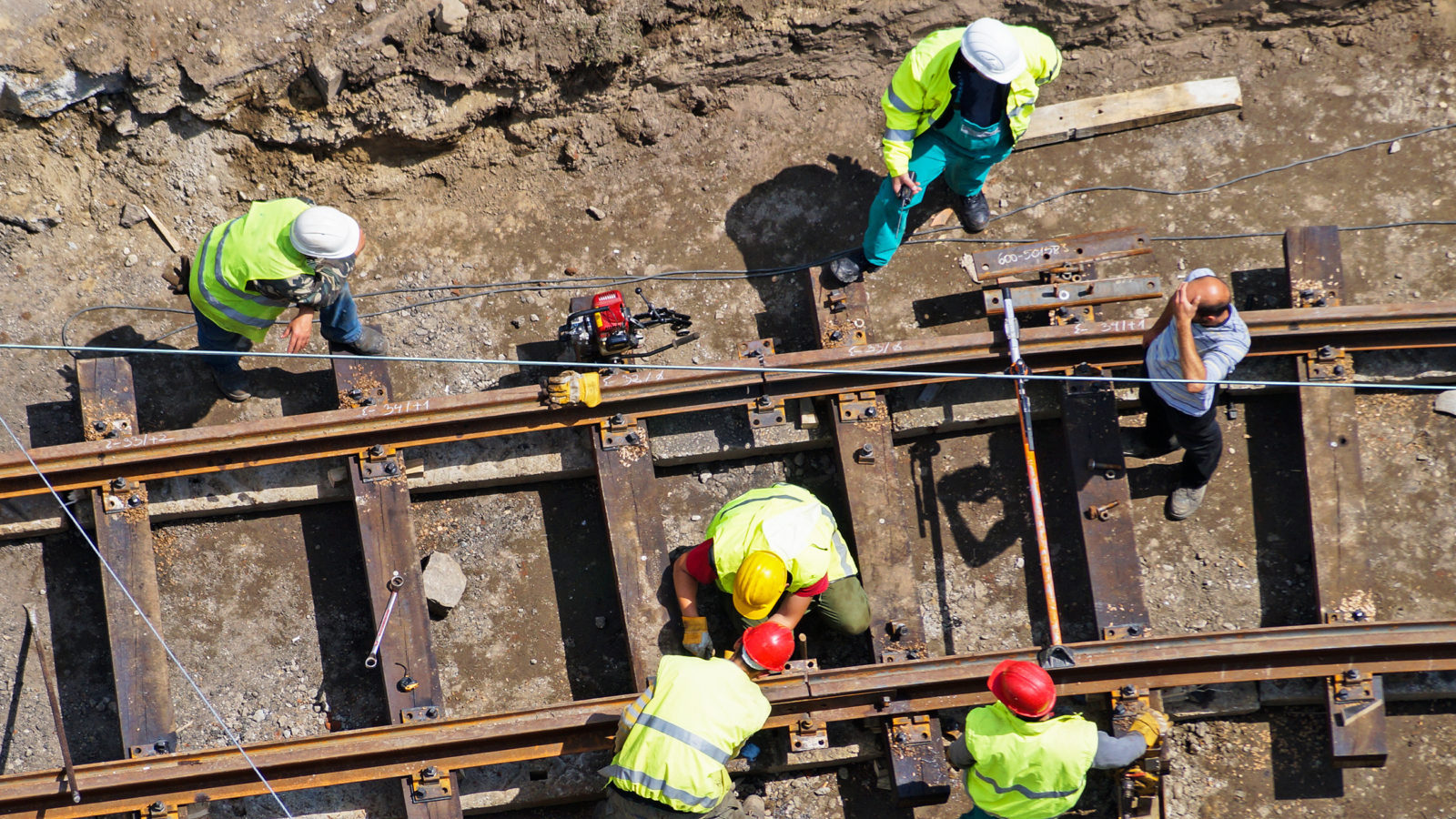 construction workers are building a new railway line