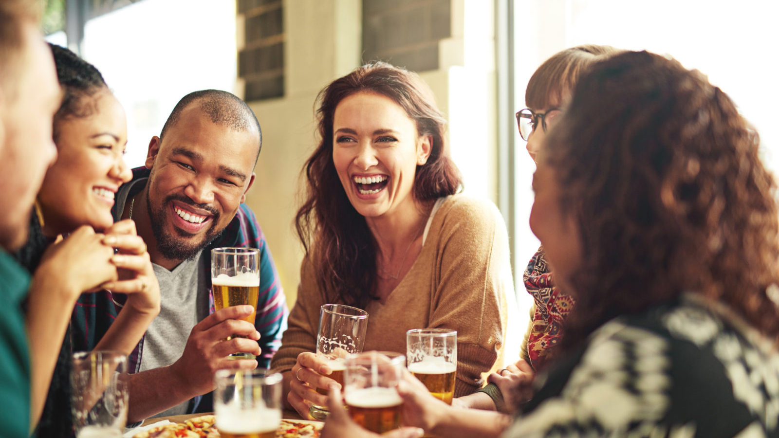 Shot of a group of friends hanging out and having beer