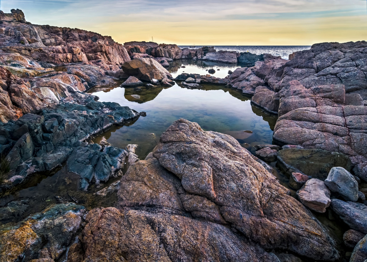 Rocks on the beach by Karin Strunge | metal posters