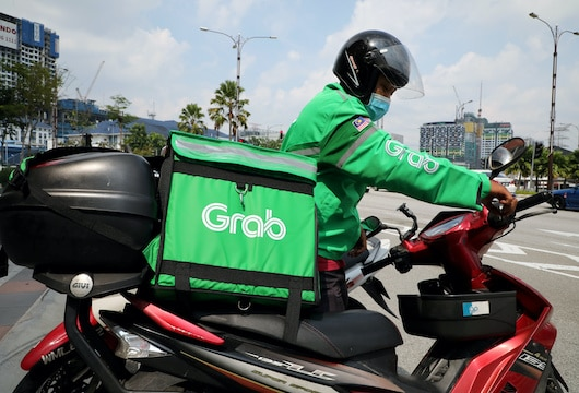 Indonesia's anti-trust watchdog fines Grab more than $3 million