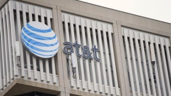 AT&T profit benefits from lower churn