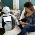 """New recruit """"Pepper"""" the robot, a humanoid robot designed to welcome and take care of visitors and patients. REUTERS/Francois Lenoir"""