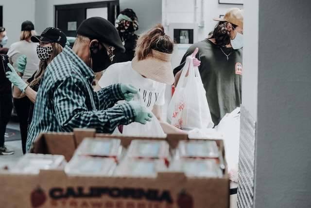 people repacking donations