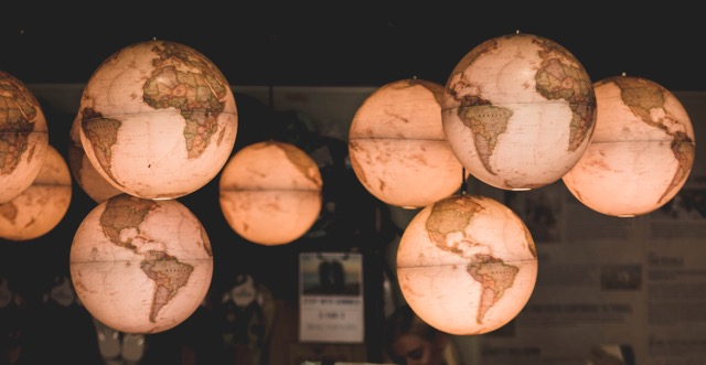 Lighted globes hanging from ceiling