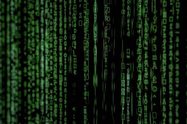 Strings of green binary code.