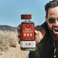 Bottle of Tres Comas held by Russ Hanneman, character on Silicon Valley