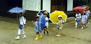Children with bright umbrellas