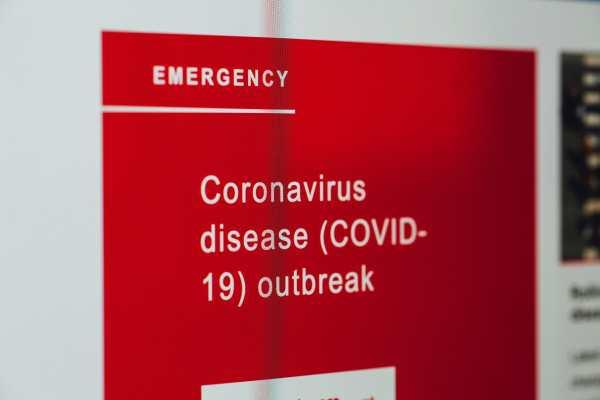 Emergency red sign about Coronavirus disease outbreak