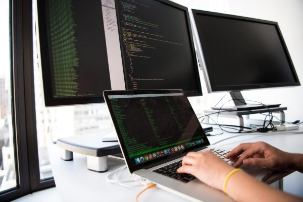 Coder writing on multiple screens