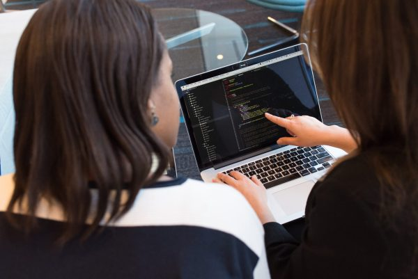 Women coding in laptop
