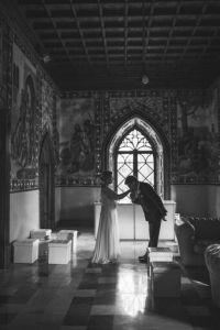 A couple share a few moments alone in a majestic venue.
