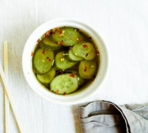 Spicy pickled cucumbers in a dish.