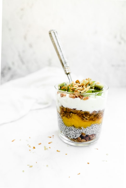 Tropical fruit parfait layered with homemade honey ginger granola and chia pudding.