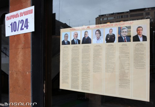 Armenia -- Photos of presidential candidates at a polling station ahead of Elections 2013, 17Feb2013 | Photolur photo via Azatutyun.am
