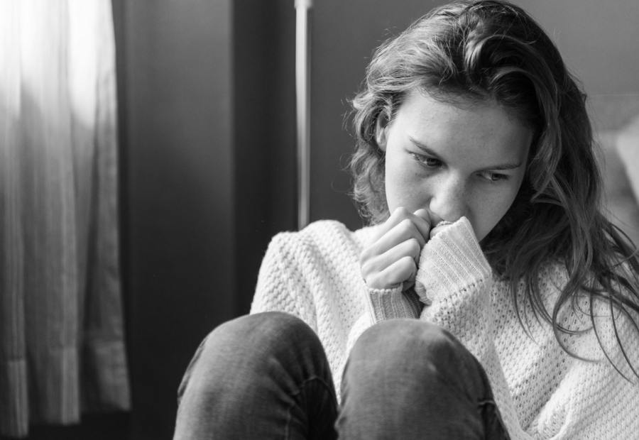 concerned woman thinking about heavy menstrual bleeding