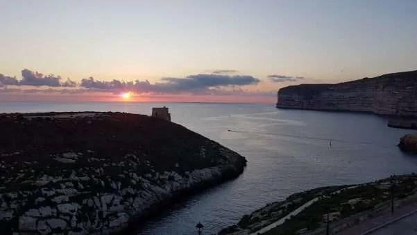 Sunset behind Xlendi Tower