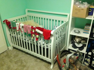 There is another child's room, with another crib in it and an infant car seat.