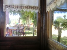 And this was the view from my window, the one next to me. Here you can see some tables outdoors.
