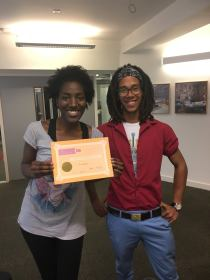 "Awarded ""Creative Contribution to the Student Community"" by Arts SU, presented by Leroy"