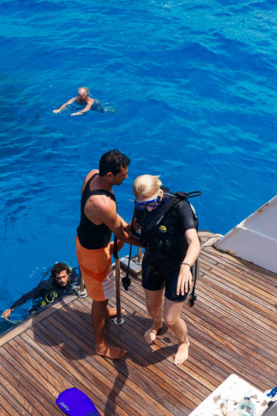 HURGHADA EGYPT - MAY 19 2015: Scuba diving instructor checking equipment before dive.