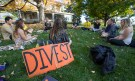 (Harrisonburg)  Members of Divest JMU hold a teach-in on the lawn in front of the Hillcrest House to help educate the student community on fossil fuel dependance.  (Daniel Lin/Daily News-Record)