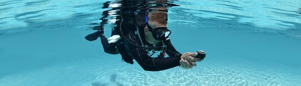 Diver using compass