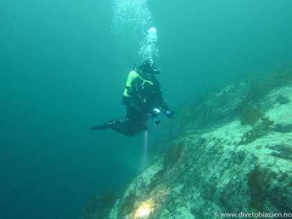Toppen av bergvegg, dykker