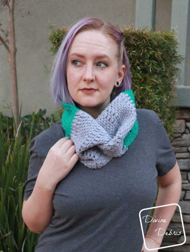 Learn how to make the Whitney Cowl, a design that combines the linen stitch, a simple puff stitch, and finished with a twist, from a free crochet pattern on DivineDebris.com