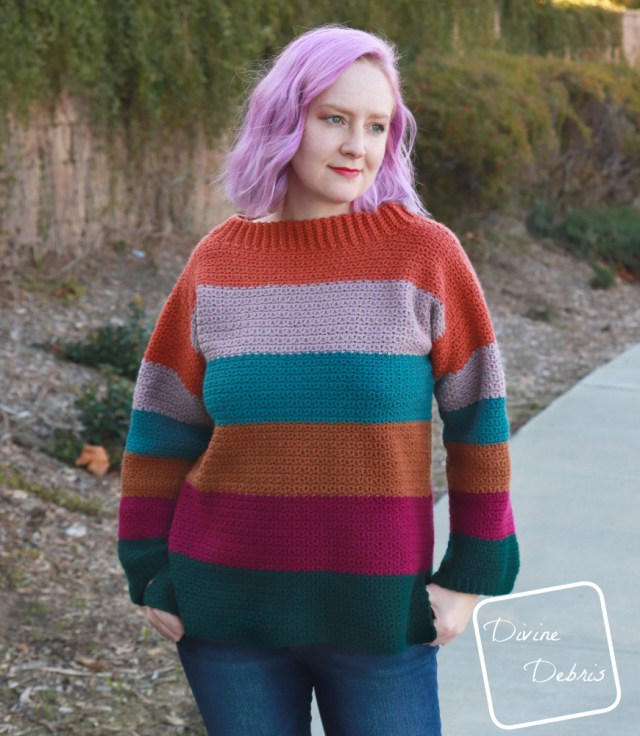 [image description] White woman in striped crochet Amelia Pullover crochet pattern looking to the right in front of a wall of ivy