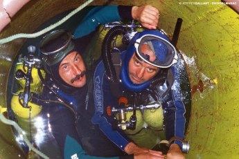 Romanian aquanauts Liviu Miron and Constantin Mihaï entering the L.S.-1 Underwater Laboratory in Lake Bicaz, Romania, in 1995. Photo © Jeffrey Gallant | Diving Almanac