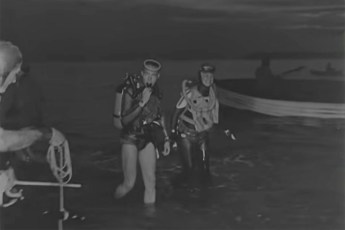 Fred and Jane Baldasare during Jane's first attempt to dive across the English Channel in 1960. Image: Film still by British Pathé.