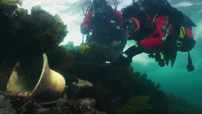 Paul Boissinot and Richard Savignac recreating the discovery of the ship's bell of HMS Erebus. Video still by Mario Cyr | Canada 150