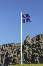 The flag of Iceland at the site of the Alþing – Assembly Fields – the oldest extant parliamentary institution in the world founded in 930, which is only 500 metres from Silfra. Photo © Jeffrey Gallant | Diving Almanac