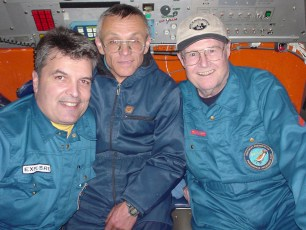 Capt. Craig McLean (left, NOAA), Mir pilot Viktor Nischeta, and Dr. George Bass (Institute for Nautical Archaeology) get ready to descend to the Titanic in Mir 2 to complete the photo mosaic. Photo: NOAA