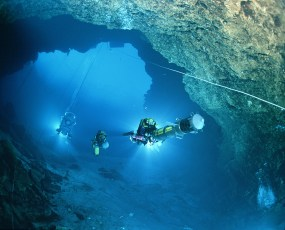 "Jill Heinerth at the helm of the ""Mapper"" at Wakulla Springs, Florida. Photo by Wes Skiles courtesy U.S. Deep Caving Team"