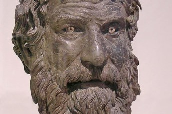 The bronze head of a philosopher recovered from the Antikythera shipwreck in 1901, part of a life-sized statue of the man. Photo by Ishkabibble (Creative Commons)