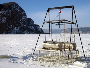GEERG's shark observation cage suspended in ice on the Saguenay Fjord in 2002. Photo © Jeffrey Gallant   GEERG