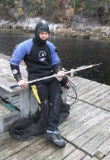 Jean-Yves Forest is ready to deploy an acoustic transmitter on a Greenland shark. Photo © Jeffrey Gallant   GEERG