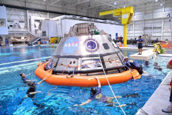 U.S. Navy divers, Air Force pararescuemen and Coast Guard rescue swimmers practice Orion recovery techniques at the Neutral Buoyancy Laboratory (NBL) at the agency's Johnson Space Center in Houston. Photo by James Blair | NASA | NBL (Public Domain)