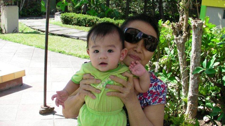 Ama holding Cyrus baby